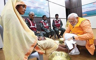 Prime Minister Modi washing the feet of Safai Karamacharies Apt Recognition to Sanitation Workers